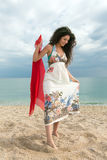 Girl walking on beach Stock Photo