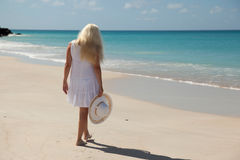 Girl walking on the beach Royalty Free Stock Image