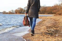 Girl walking on the beach Stock Image