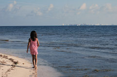 Girl walking at the beach Royalty Free Stock Images