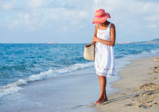 Girl walking at the beach Stock Images
