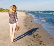 Girl walking at beach Royalty Free Stock Image