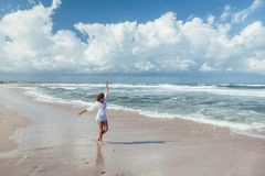 Girl walking on the beach stock image