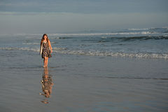 Girl walking on the beach. Royalty Free Stock Photos