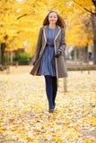 Girl walking on a beautiful fall day Stock Image
