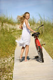 Girl Walking Bike on Boardwalk. Stock Photography