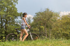 Girl walking with bike Royalty Free Stock Images