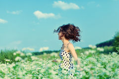Girl walking on the buckwheat field Stock Images