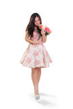Girl walking with bunch of roses full length isolated Royalty Free Stock Image