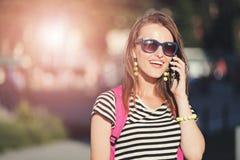 Girl Walking And Calling On Smartphone