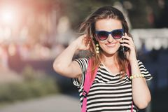 Girl Walking And Calling On Smartphone royalty free stock photography