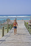 Girl walking on a Cayman Island Dock Stock Photos