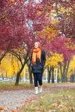 Girl walking in city park, autumn season Royalty Free Stock Photography