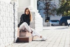Girl walking in city street Stock Photos