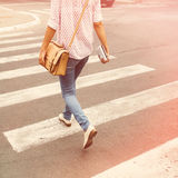 Girl walking in the city. Young woman walking in the city Royalty Free Stock Photos