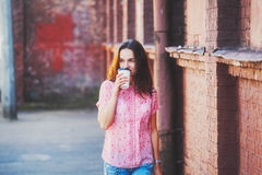 Girl walking with coffee Royalty Free Stock Images