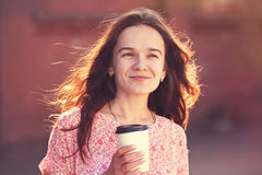 Girl walking with coffee Royalty Free Stock Photos