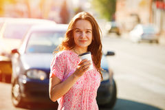 Girl walking with coffee Stock Photography