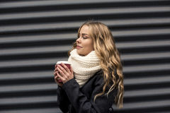 Girl walking with coffee to go Stock Image