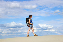 Girl walking in the desert Stock Photography