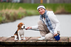 Girl walking with a dog stock photo