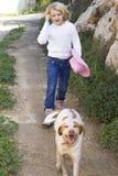 Girl walking dog royalty free stock photo