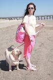 Girl walking dog royalty free stock image