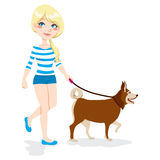Girl Walking Dog. Young pretty blond girl walking with dog Stock Image