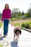 Girl walking a dog Royalty Free Stock Photo