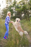 Girl walking with a dog Royalty Free Stock Images