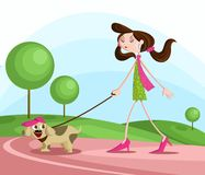 Girl walking with dog Royalty Free Stock Image