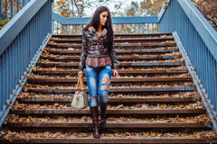 Girl walking down the stairs Royalty Free Stock Photos