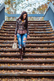 Girl walking down the stairs Royalty Free Stock Photography