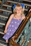 Girl walking down the stairs Royalty Free Stock Photo
