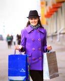 Girl walking down the street Stock Photo