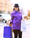 Girl walking down the street with shopping Stock Photos