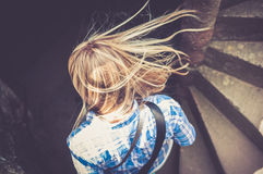 Girl walking downstairs Royalty Free Stock Photography