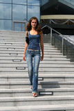 Girl walking dowstairs Stock Photos