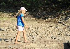 Girl walking on dry ground Royalty Free Stock Image