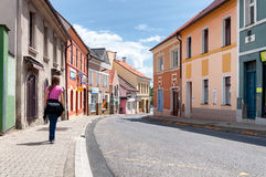 Girl Walking by empty streets in small town Kladno Stock Photography