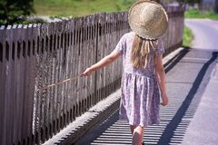 Girl walking at fence Royalty Free Stock Photo