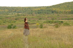 Girl walking in the field Royalty Free Stock Photo