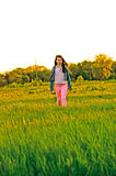 Girl walking in a field Royalty Free Stock Photography