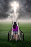 Girl walking at field to the heaven Stock Image