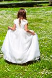 Girl walking in flower field. Royalty Free Stock Photography