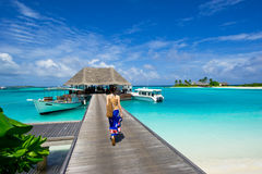 Girl walking on the footbridge in maldives Stock Photo