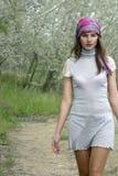 Girl walking through the garden Stock Photography