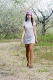 Girl walking through the garden Royalty Free Stock Images