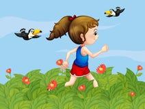 A girl walking at the garden with birds Royalty Free Stock Photos