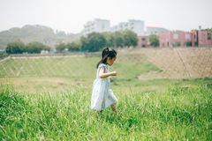 Girl walking in the garden. Chinese girl  walking in the green garden Royalty Free Stock Image